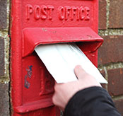 Person posting a letter